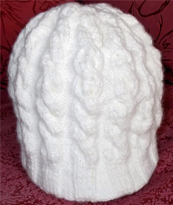 вязаная шапка косами на спицах
